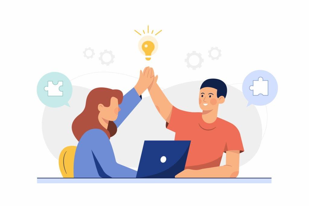 femme et homme se tapent dans la main après travail réussi